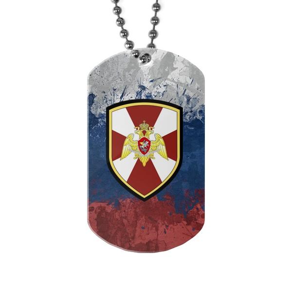 Жетон с эмблемой Нацгвардии на фоне флага России
